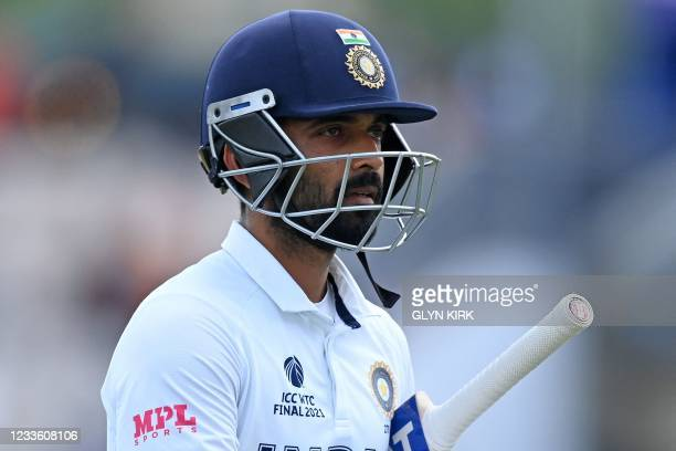 India's Ajinkya Rahane walks back to the pavilion after losing his wicket for 15 runs on the final day of the ICC World Test Championship Final...