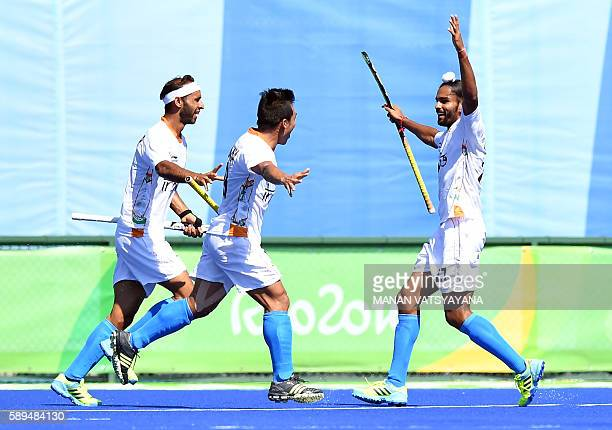 India's Akashdeep Singh celebrates a goal with teammates during the men's quarterfinal field hockey Belgium vs India match of the Rio 2016 Olympics...