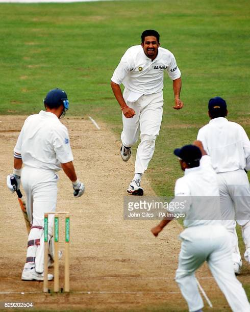 India's Anil Kumble runs towards his team-mates in celebration after taking the wicket of England's captain Nasser Hussain during the final day of...