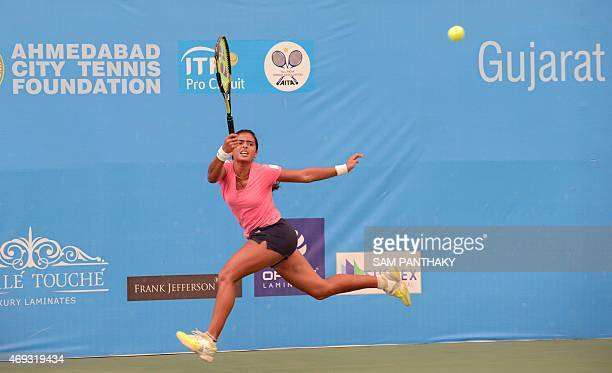 India's Ankita Raina hits a shot against Latvia's Anastasija Sevastova in the women's singles final at the Gujarat ITF Pro 2015 tennis tournament in...