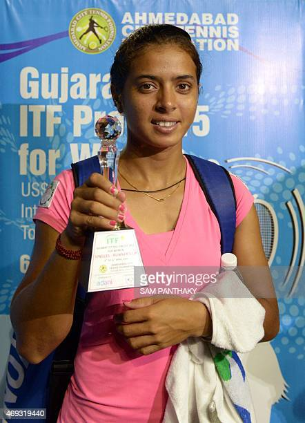 India's Ankita Raina holds her trophy after losing the women's singles final at the Gujarat ITF Pro 2015 tennis tournament in Ahmedabad on April 11...