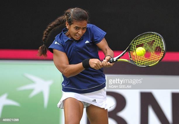 India's Ankita Raina returns to Malasysia's Jawairiah Noordin during the Fed Cup AsiaOceana Group II Tennis Championship at Fateh Maidan Tennis...
