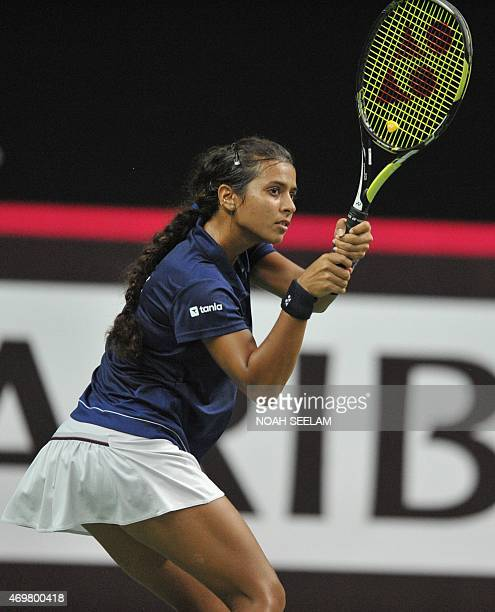 India's Ankita Raina returns to Pakistan's Ushna Suhail during the Fed Cup AsiaOceana Group II Tennis Championship at Fateh Maidan Tennis complex in...