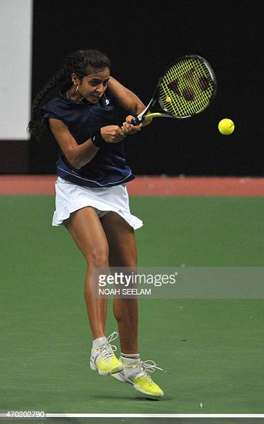 India's Ankita Raina returns to the Philippines' Katharina Lehnert in the Fed CupOceana Group II Tennis Championship final at Fateh Maidan Tennis...