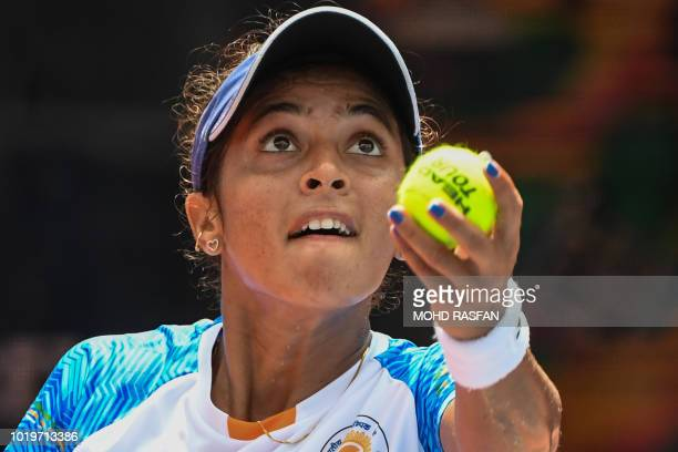 India's Ankita Ravinderkrishan Raina serves against Indonesia's Beatrice Gumulya in their women's singles tennis match during the 2018 Asian Games in...