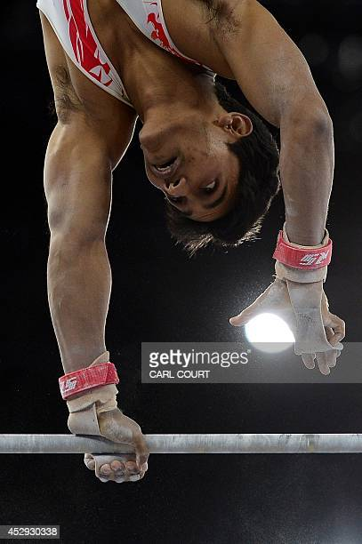 India's Ashish Kumar performs on the high bar during the men's all round final of the Artistic Gymnastics event during the 2014 Commonwealth Games in...