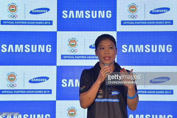 India's Asian Games boxing gold medallist Mary Kom speaks during an event for returning Indian athletes from the 2014 Incheon Asian Games in New...