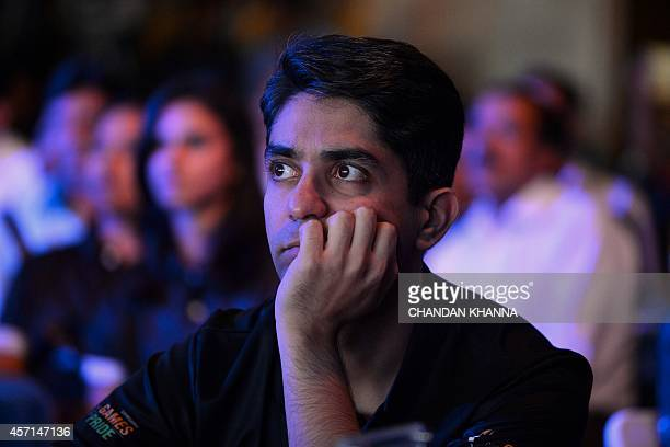 India's Asian Games shooting bronse gold medallist Abhinav Bindra looks on during an event for returning Indian athletes from the 2014 Incheon Asian...