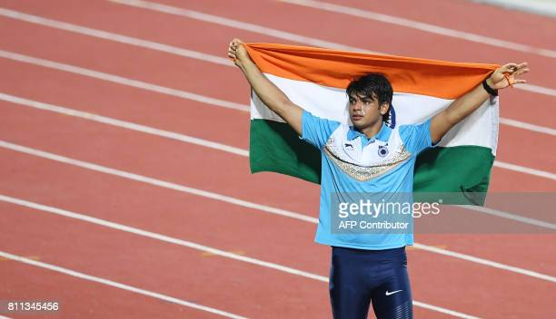 India's athletes Neeraj Chopra celebrates after placing first in the javelin throw event during the final day of the 22nd Asian Athletics...
