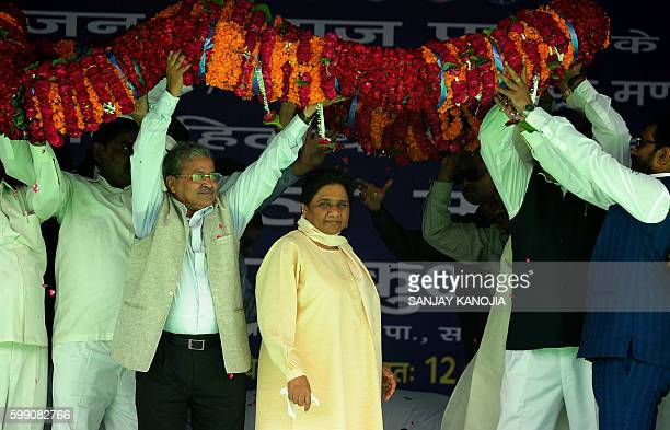 India's Bahujan Samaj Party leader Mayawati is garlanded by party leaders as she arrives to address a public rally at Parade Ground in Allahabad on...