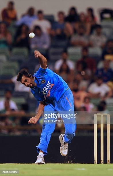 India's Barinder Sarn bowls during the T20 cricket match between India and a Western Australian XI in Perth on January 8 2016 AFP PHOTO / Greg WOOD...