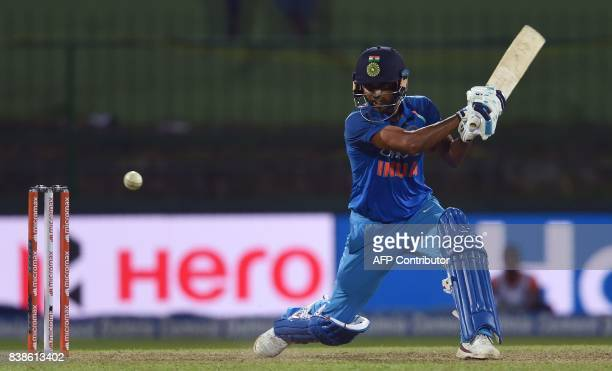 India's batsman Bhuvneshwar Kumar plays a shot during the second One Day International cricket match between Sri Lanka and India at the Pallekele...