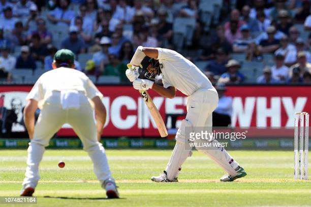 India's batsman Cheteshwar Pujara plays a defensive shot during day one of the third cricket Test match between Australia and India in Melbourne on...