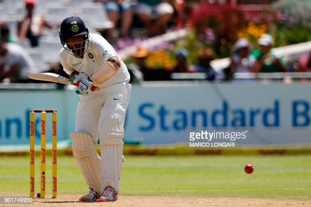 India's batsman Cheteshwar Pujara prepares to play a shot during the second day of the first Test cricket match between South Africa and India at...