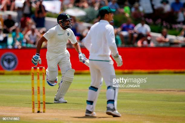 India's batsman Cheteshwar Pujara runs during the second day of the first Test cricket match between South Africa and India at Newlands in Cape Town...