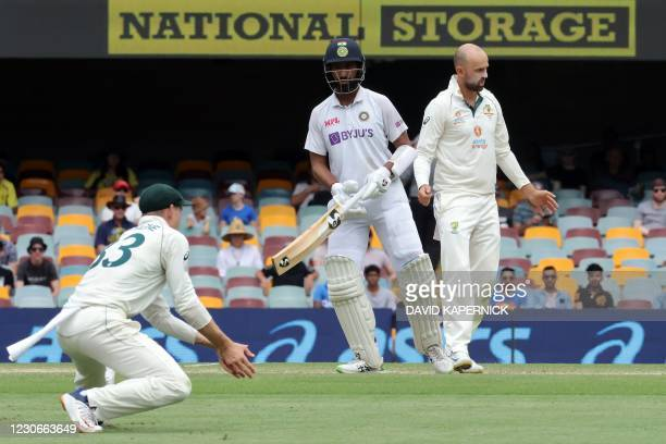 India's batsman Cheteshwar Pujara watches Australia's Marnus Labuschagne fielding the ball on day five of the fourth cricket Test match between...