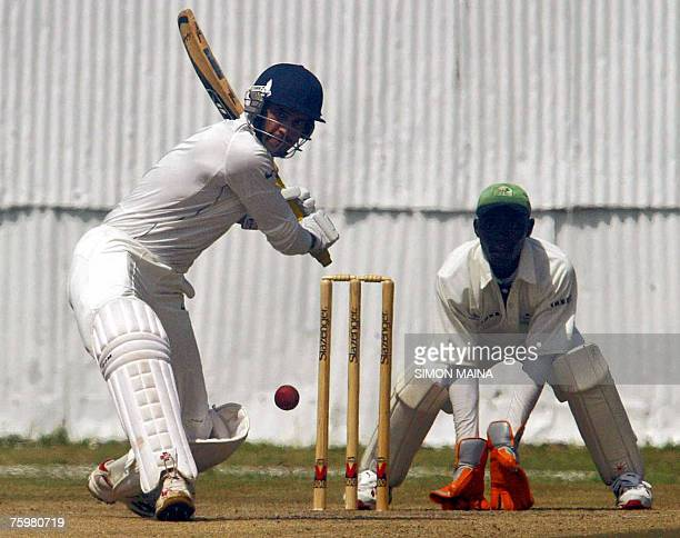 India's batsman Irfan Pathan hits a delievery against Kenya as wicket keeper Maurice Ouma 06 August 2007during a three day match at the Mombasa...