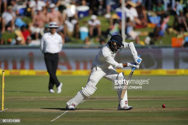 India's batsman Murali Vijay hits a shot on the first day of the first Test cricket match between South Africa and India at Newlands in Cape Town on...