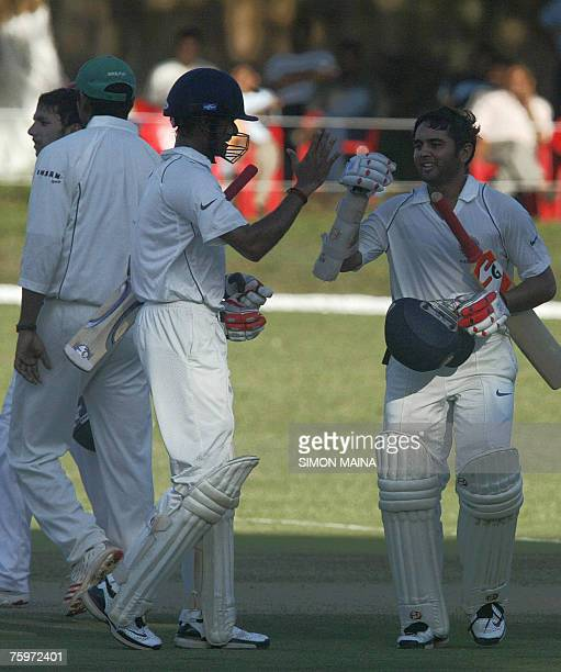 India's batsman Parthiv Patel celebrates with Subramaniam Badrinath after beating Kenya 05 August 2007 as part of a threeday game at the Mombasa...