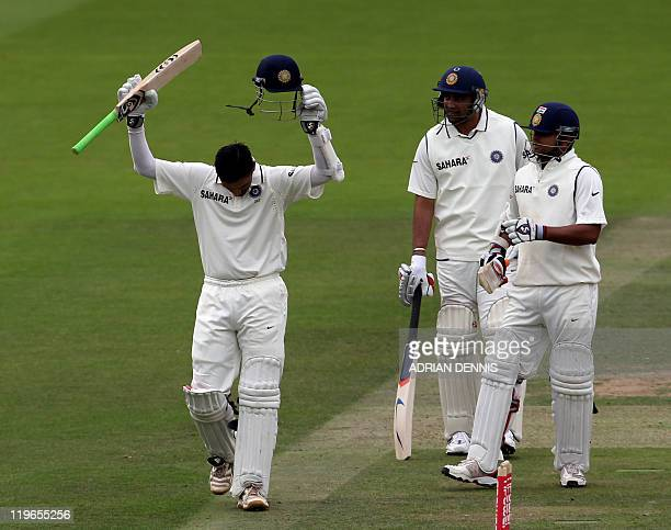 India's batsman Rahul Dravid celebrates scoring a century while teammate Suresh Raina and Zaheer Khan look on against England during day three of the...