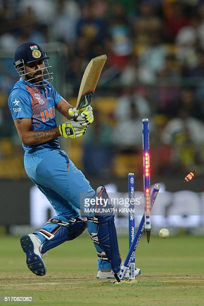 India's batsman Ravindra Jadeja is bowled by Bangladesh bowler Mustafizur Rahman during the World T20 cricket tournament match between India and...
