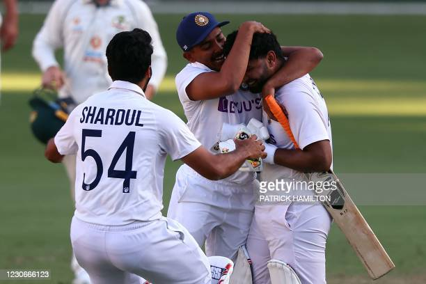 India's batsman Rishabh Pant celebrates victory with teammates in the fourth cricket Test match against Australia at The Gabba in Brisbane on January...