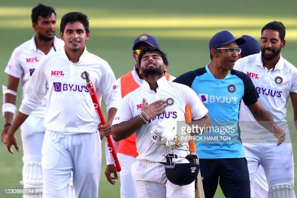 India's batsman Rishabh Pant gestures as team celebrate victory in the fourth cricket Test match against Australia at The Gabba in Brisbane on...