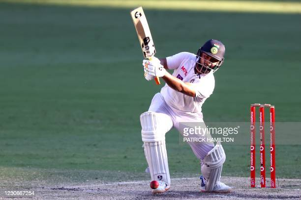 India's batsman Rishabh Pant plays a winning shot on the fifth day of the fourth cricket Test match between Australia and India at The Gabba in...