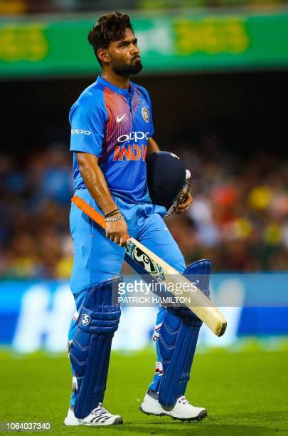 India's batsman Rishabh Pant reacts during the T20 international cricket match between Australia and India in Brisbane on November 21 2018 / IMAGE...