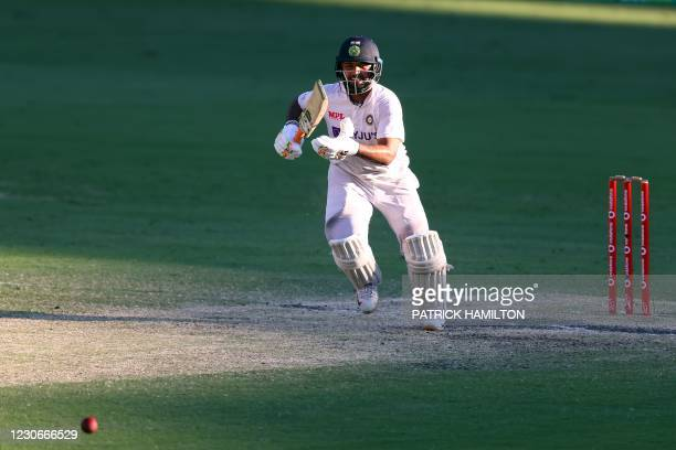 India's batsman Rishabh Pant smiles as he takes a winning run at the end of the fourth cricket Test match between Australia and India at The Gabba in...