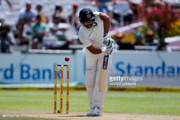 India's batsman Rohit Sharma misses a shot off a delivery by South Africa's bowler Vernon Philander during the second day of the first Test cricket...