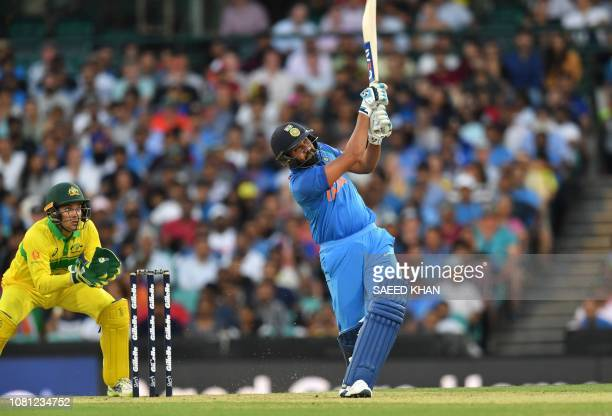 India's batsman Rohit Sharma plays a shot during first oneday international match between Australia and India at the Sydney Cricket Ground in Sydney...