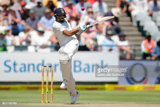 India's batsman Rohit Sharma plays a shot during the second day of the first Test cricket match between South Africa and India at Newlands cricket...