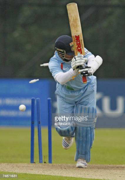 India's batsman Sachin Tendulkar is bowled out 23 June 2007 from Ireland's Roger Whelan Ireland during the One Day International match at Stormont...