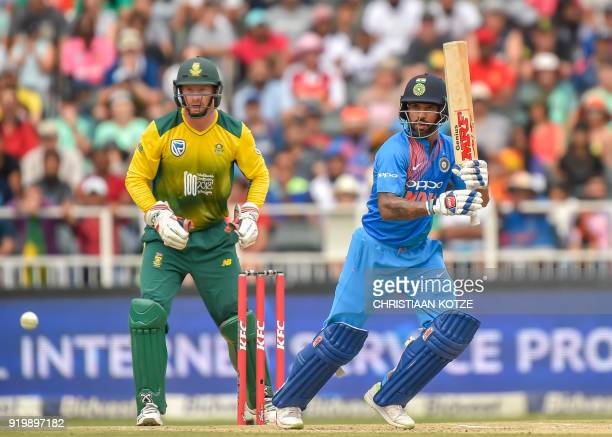 India's batsman Shikhar Dhawan is watched by South Africa's wicketkeeper Heinrich Klaasen as he plays a shot during the first T20I cricket match...