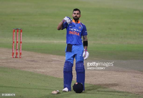 India's batsman Virat Kohli celebrates after scoring a century during the first One Day International cricket match between South Africa and India at...