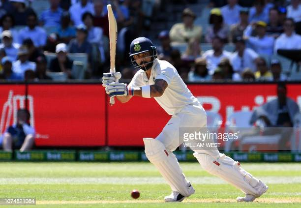India's batsman Virat Kohli plays a shot during day one of the third cricket Test match between Australia and India in Melbourne on December 26,...