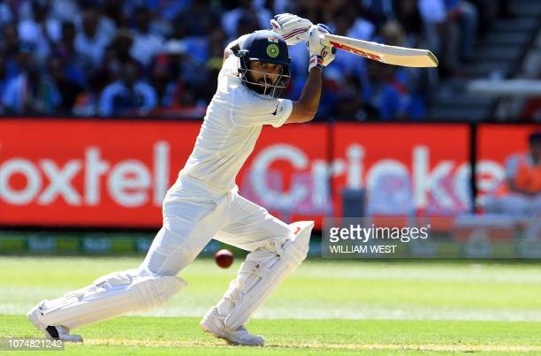 India's batsman Virat Kohli plays a shot during day one of the third cricket Test match between Australia and India in Melbourne on December 26 2018...