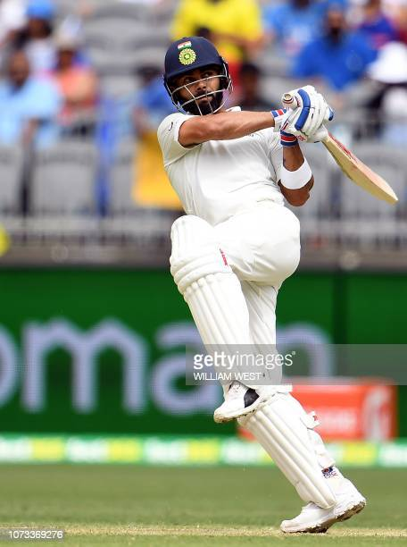 India's batsman Virat Kohli plays a shot during day two of the second Test cricket match between Australia and India in Perth on December 15 2018 /...