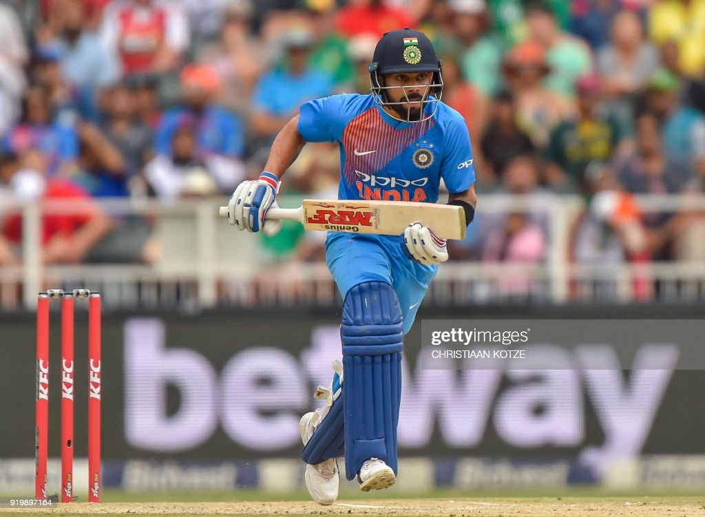 India's batsman Virat Kohli runs between the wickets during the first T20I cricket match between South Africa and India at The Wanderers Cricket Stadium in Johannesburg on February 18, 2018. / AFP PHOTO / Christiaan Kotze