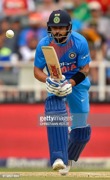 India's batsman Virat Kohli watches the ball after playing a shot during the first T20I cricket match between South Africa and India at The Wanderers...