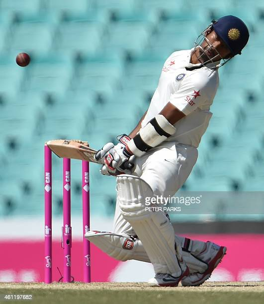 India's batsman Wriddhiman Saha avoids a bouncer from Australian bowler Mitchel Starc during day four of the fourth cricket Test between Australia...