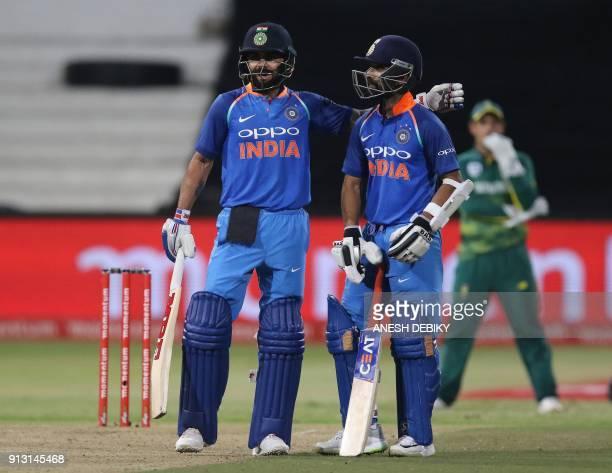 India's batsmen Virat Kohli and Ajinkya Rahane celebrate the 100 partnership during the first One Day International cricket match between South...