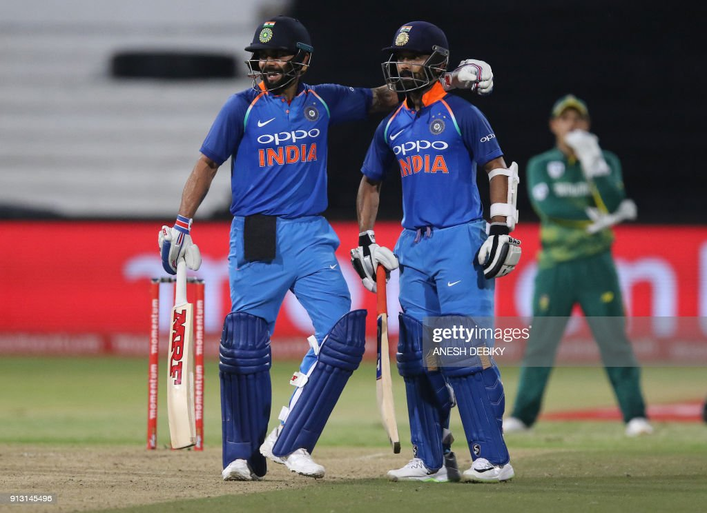 India's batsmen Virat Kohli (L) and Ajinkya Rahane celebrate the 100 partnership during the first One Day International (ODI) cricket match between South Africa and India at Kingsmead Cricket Ground on February 1, 2018 in Durban. /