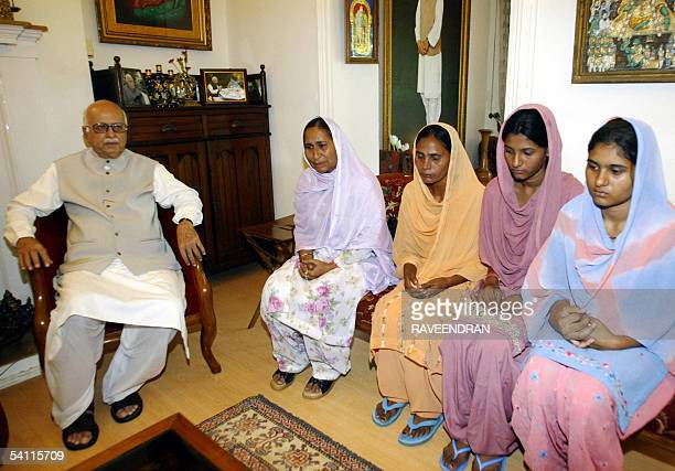 India's Bharatiya Janata Party President Lal Krishna Advani speaks with Dalbir Kaur and Sukhpreet Kaur sister and wife of Sarabjit Singh an Indian...