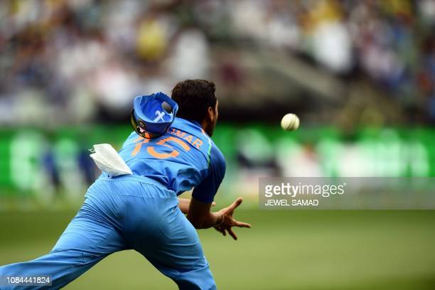 India's Bhuvneshwar Kumar catches the ball to dismiss Australia's Glenn Maxwell during the third one-day international cricket match between...