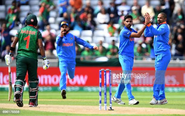 India's Bhuvneshwar Kumar celebrates the dismissal of Bagladesh's Sabbir Rahman during the ICC Champions Trophy semifinal cricket match between India...