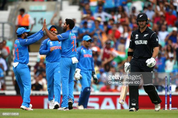 India's Bhuvneshwar Kumar celebrates with team mates after bowling out Corey Anderson of New Zealand during the ICC Champions Trophy Warmup match...
