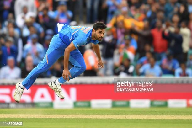India's Bhuvneshwar Kumar delivers a ball during the 2019 Cricket World Cup group stage match between India and Australia at The Oval in London on...