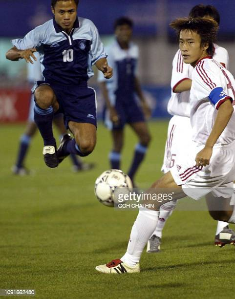 India's Bijen Singh leaps to retrieve the ball pass China's captain Du Wei during a match at the Yangsan stadium in the 14th Asian Games in Busan 03...